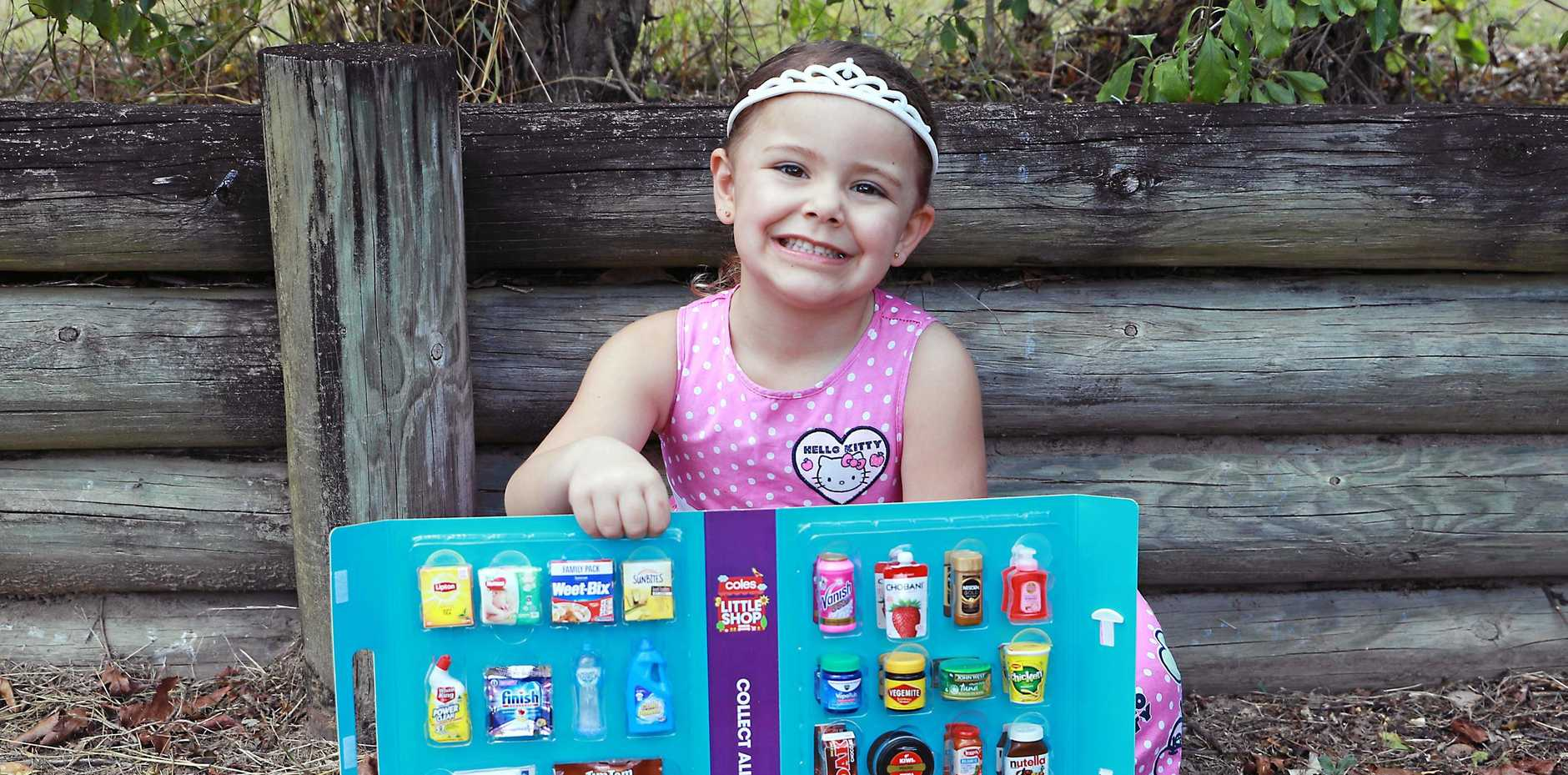 Hayley Hughes with her treasured Coles Little Shop collection.