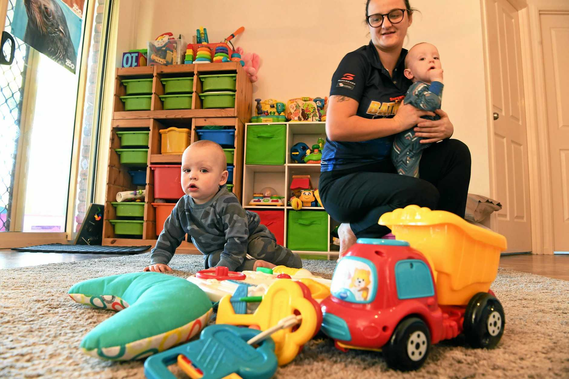 PAYMENT FAIL: Jasmin Sharpe with Elijah and Ethan Bishop. Jasmin is struggling with the Federal Government's Child Care Subsidy changes, which rolled over in July.