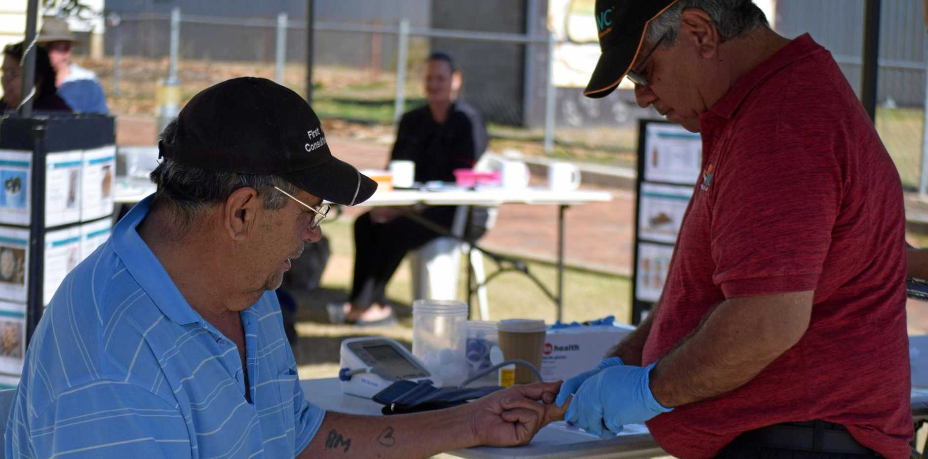 Paul Mailman receives a health check from Clem Shadford during Coffee in the Park held in Gayndah today.