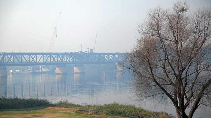 IN A HAZE: Grafton Bridge shrouded in smoke yesterday .