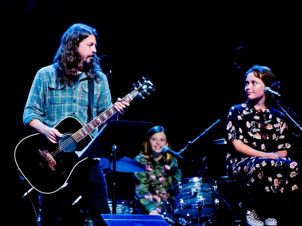 Dave Grohl with daughters Harper, (on drums) and Violet (on vocals) at a  recent hospital fundraiser.
