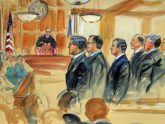 This courtroom sketch depicts Paul Manafort, fourth from right, standing with his lawyers on the first day of his trial. Picture: AP