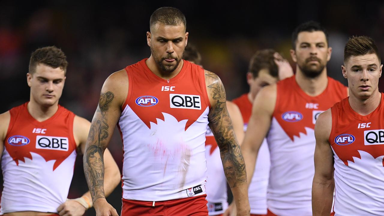 A dejected Lance Franklin walks from the ground after the Swans' loss to Essendon. Photo: Julian Smith/AAP