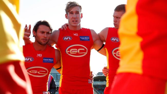Tom Lynch address his teammates before a game.