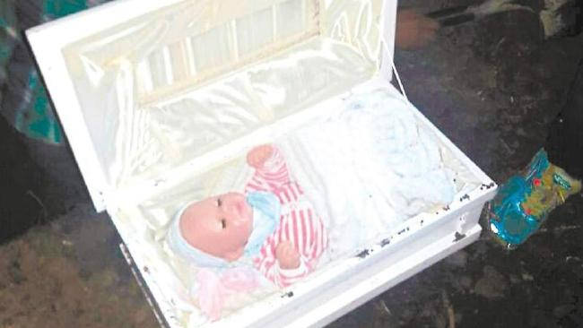 Deceived … When the coffin was opened a dressed baby doll was found inside.