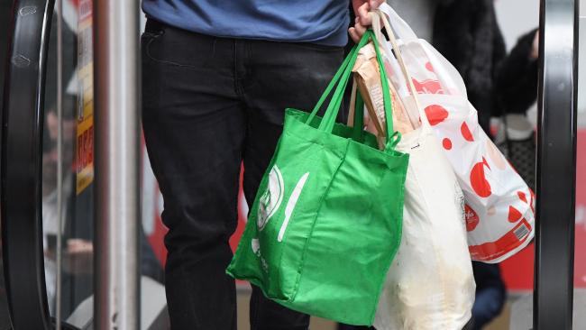 A shopper is seen carrying bags at a Coles store. Picture: AAP/Peter RAE
