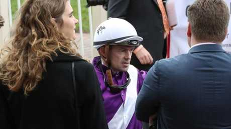 Veteran jockey Dean Yendall talks to connections at a Caulfield meeting. Picture: David Crosling