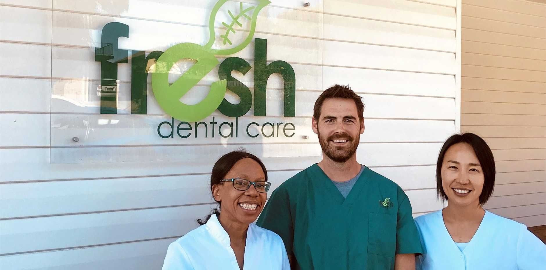 HAPPY TO HELP: Three local dentists participating in the service Dr Cecilia Mwanje, Dr Benjamin Mansell and Dr Cathy Do.