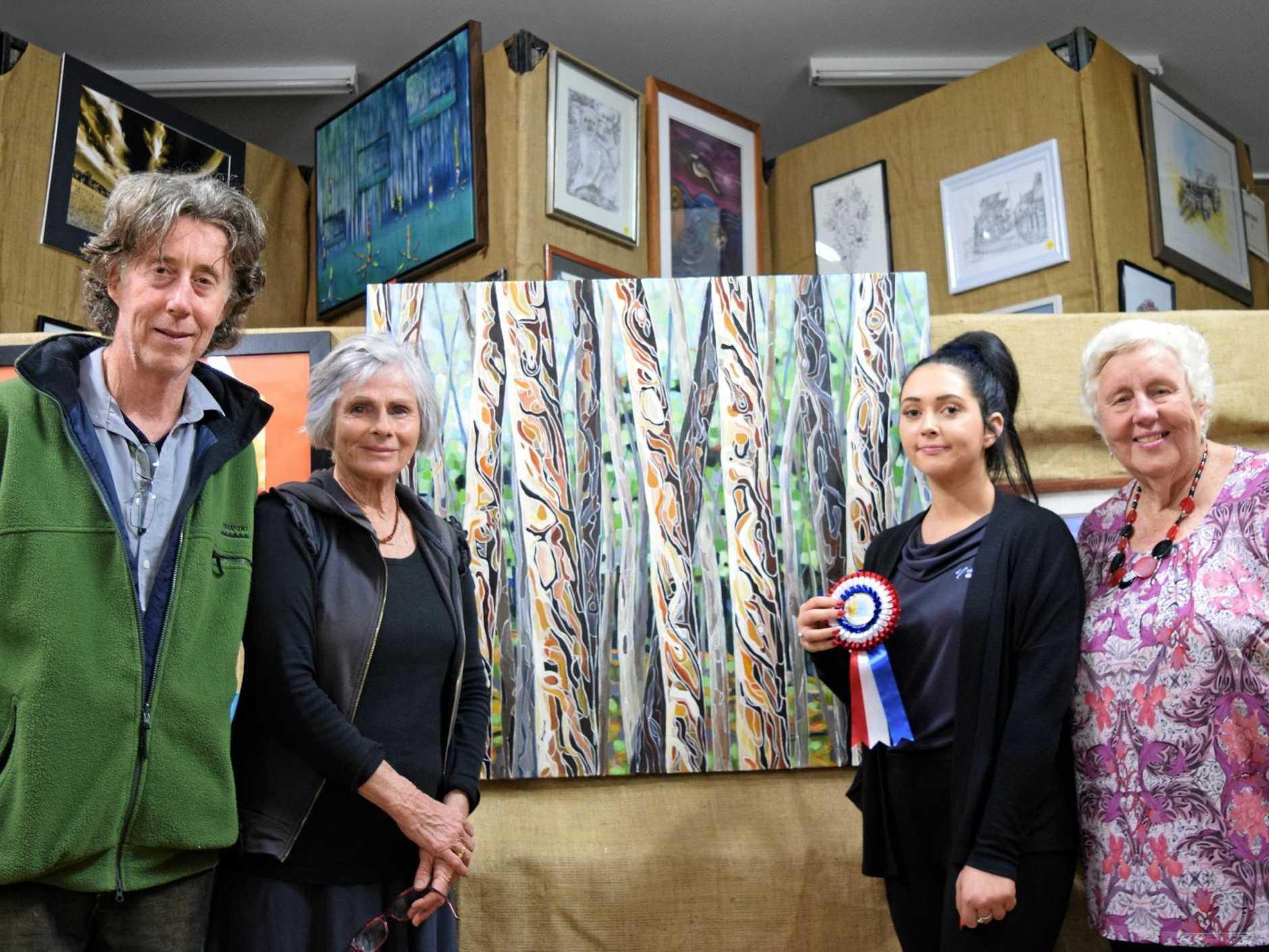 WINNER: (L-R) Bentley Art Prize judges, Oscar Giammichele and Raylee Delaney and Richmond Dairies' Ebony Collis and Bentley Art Prize coordinator Helen Trustum with winning painting by Julie McKenzie.