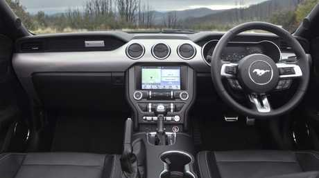 Luxurious comfort: Race-shell style front seats, infotainment screen set low though