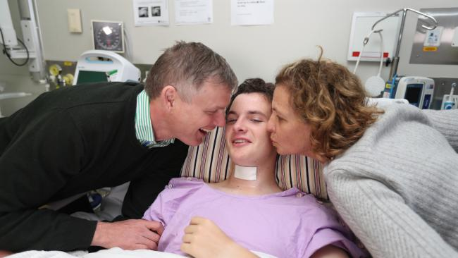 Conor Tweedy in hospital with dad Sean and mum Beck. Picture: Annette Dew