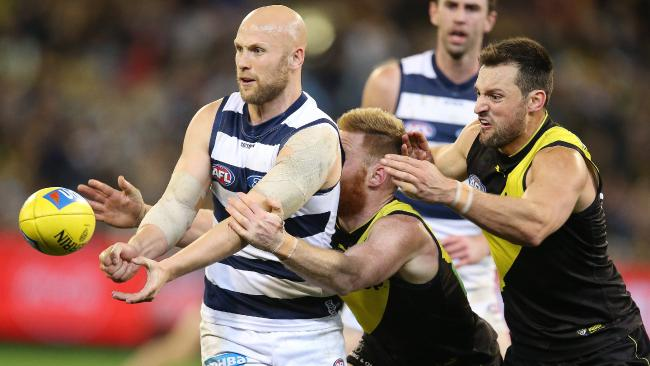 Geelong's Gary Ablett clears by hand under pressure. Picture: Michael Klein