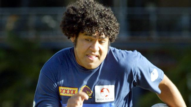 A young Sam Thaiday on the run at training.