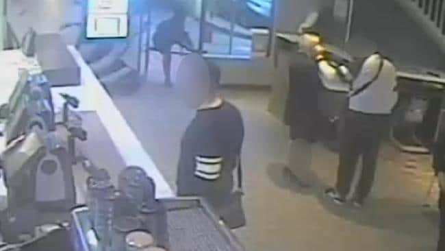 The man puts his hands on the alleged victim's face while in McDonalds, North Parramatta.