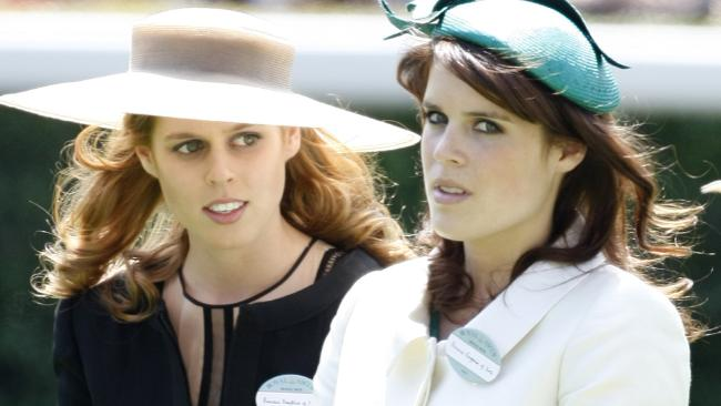 Princess Beatrice, left and Princess Eugenie have opened up on royal life for Vogue in their first joint interview. Picture: AP