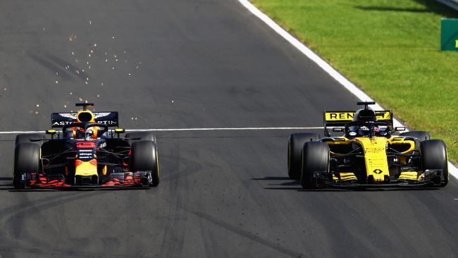 Daniel Ricciardo overtakes Renault's Nico Hulkenberg.