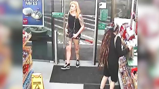 Evie Amati wanders into the 7 Eleven carrying a 2kg axe while Sharon Hacker buys milk at the cash register.