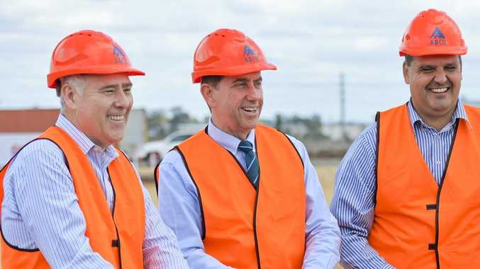 GOOD NEWS: State Development Minister Cameron Dick (centre) praised the decision.
