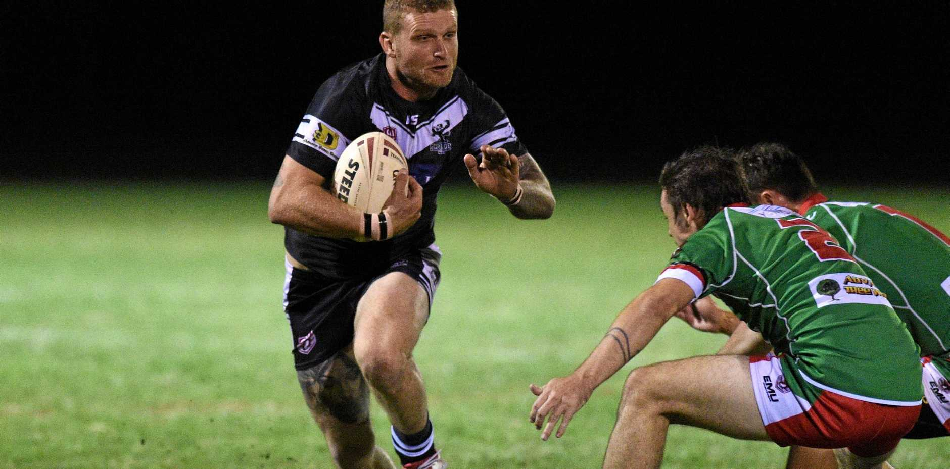 IN ACTION: Easts' Craig Bek attempts to fend off the Hervey Bay defence earlier this season.