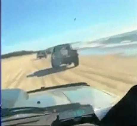 HOONS BUSTED: Police are investigating after footage emerged online of a group of motorists tearing up the beach at Double Island Point.