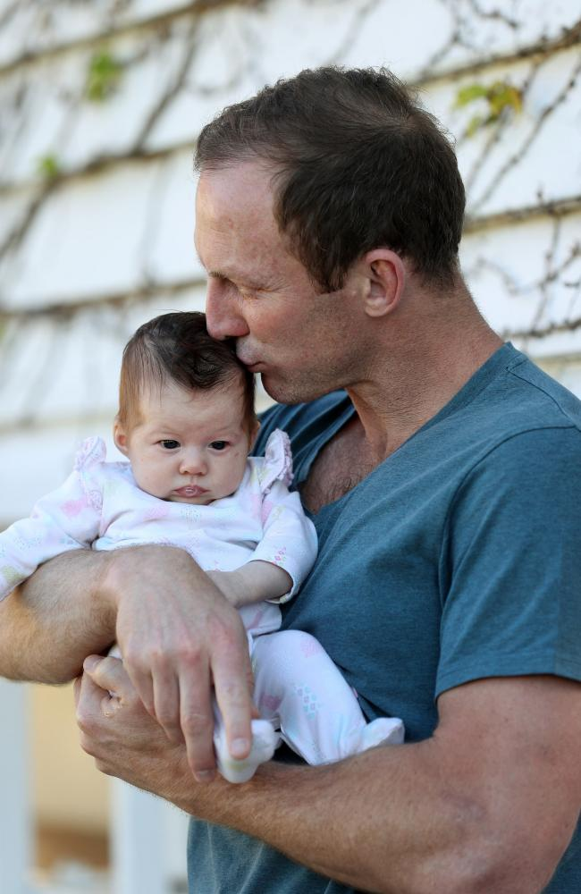 Darren Lockyer with his eight-week-old daughter Cleo. Picture: Tara Croser