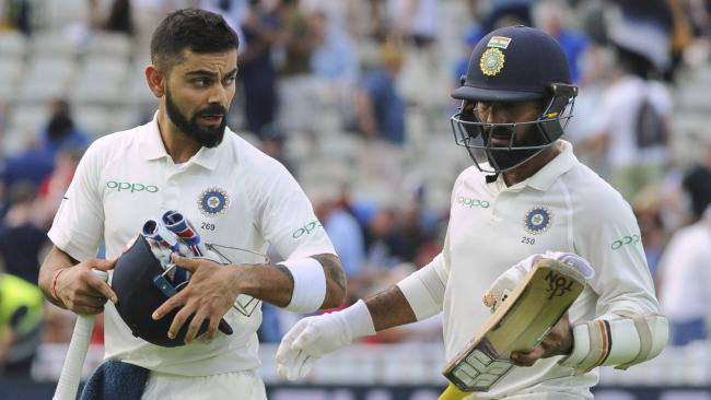 Work to be done: Indian cricket captain Virat Kohli and Dinesh Karthik leave the field at the end of the day's play at Edgbaston. Picture: AP