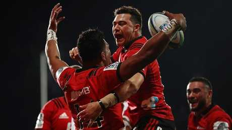 Seta Tamanivalu of the Crusaders celebrates after scoring a try with David Havili
