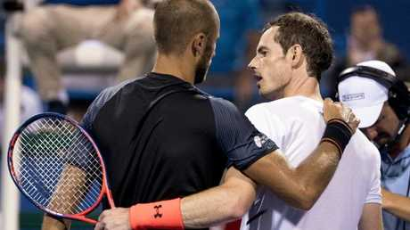 Andy Murray embraces Marius Copil after progressing to the quarter-finals. Picture: AP