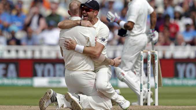 Ben Stokes celebrates with James Anderson after dismissing Virat Kohli lbw.