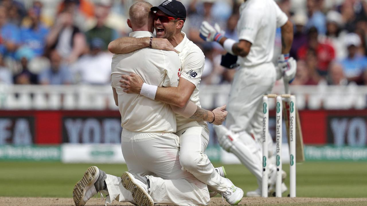 Ben Stokes celebrates with James Anderson after dismissing Virat Kohli lbw.