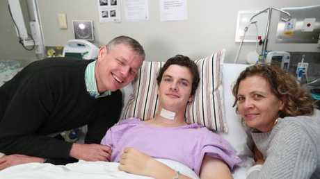 Conor Tweedy, pictured in hospital with dad Sean and mum Beck, suffered a serious spinal injury just two weeks ago. Picture: Annette Dew