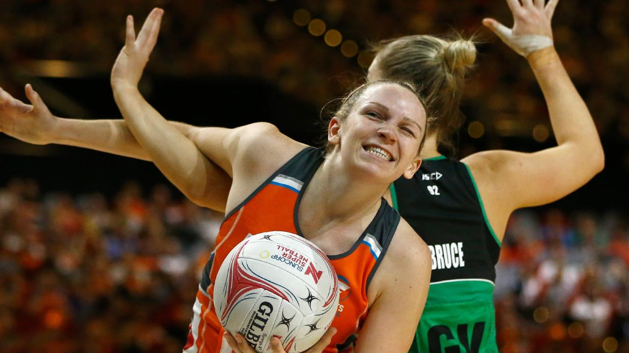 Jo Harten of the Giants (left) and Courtney Bruce of the Fever get tangled up on Saturday night. Picture: AAP