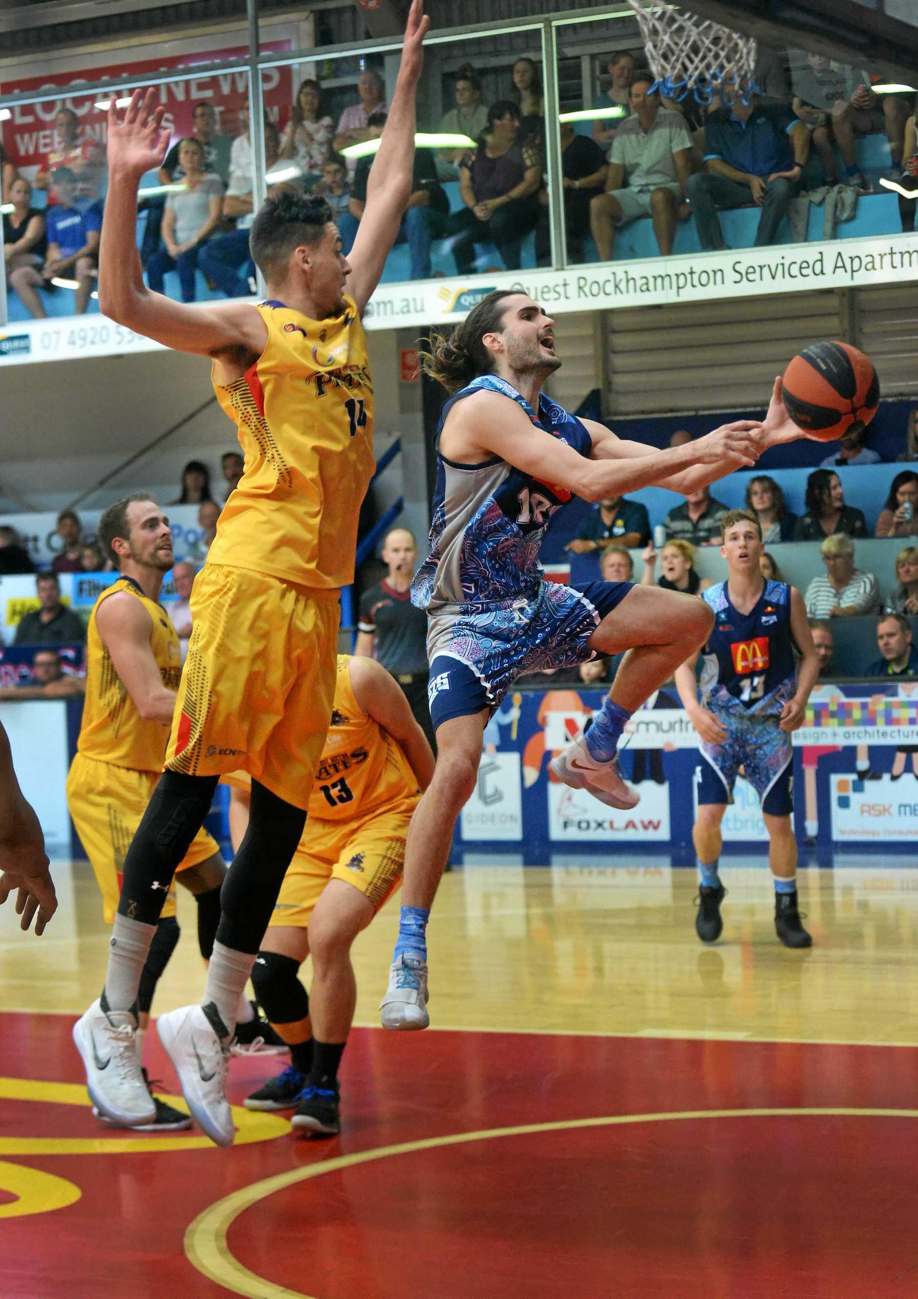 Rockhampton Rockets captain James Mitchell launches towards the basket.