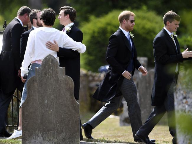 Prince Harry arrives to attend the wedding of childhood friend Charlie van Straubenzee, third right. Picture: AP