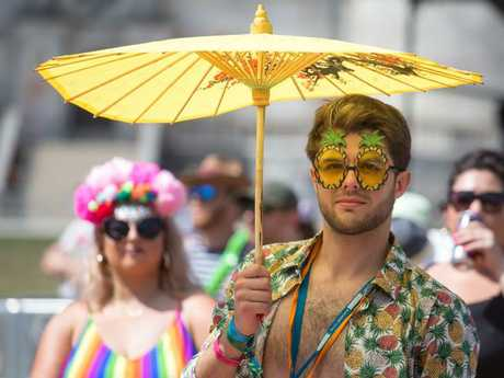 A man holds an umbrella for shade in the main arena at Bestival, at Lulworth Castle near East Lulworth in Dorset, England. Picture: Matt Cardy