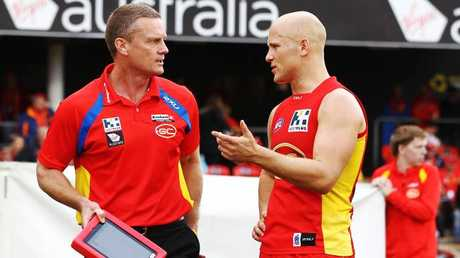 Inaugural Gold Coast coach Guy McKenna and captain Gary Ablett.