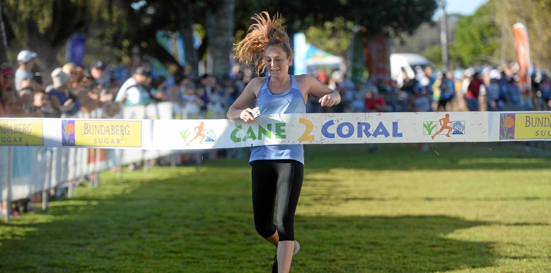 RELIEF: Gold Coast's Leshay Wells crosses the line to win the women's half marathon.