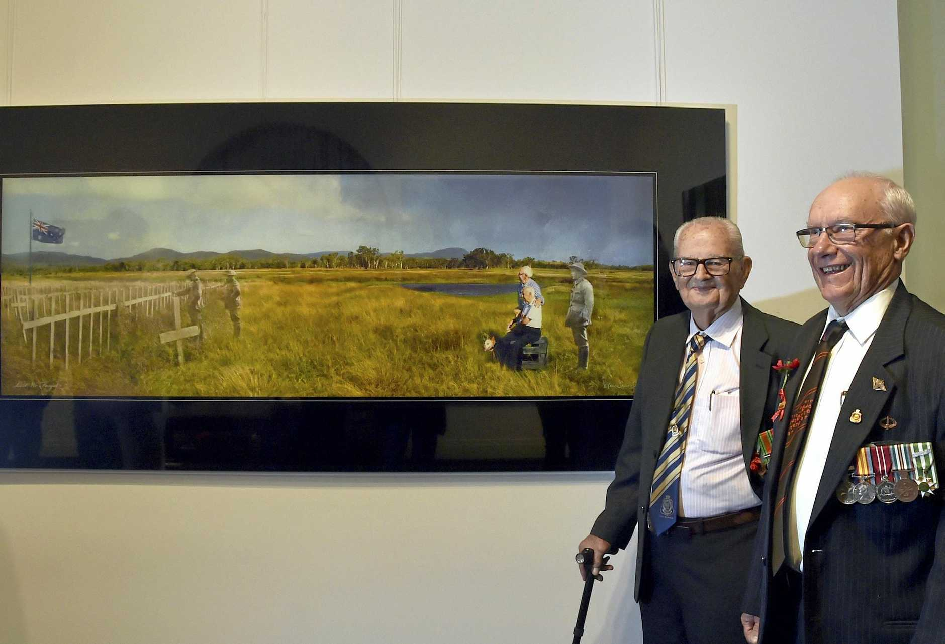 Ian Lade (left) and George Gnezdillff. WW2 veterans see the photomontage they are featured in at the Toowoomba Regional Art Gallery exhibition opening. August 2018