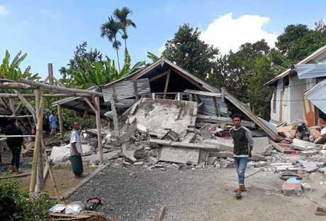 VILLAGERS walk near destroyed homes in an area affected by the early morning earthquake at Sajang village, Sembalun, East Lombok, Indonesia, on July 29, 2018. The death toll has reached 380 and is still rising.