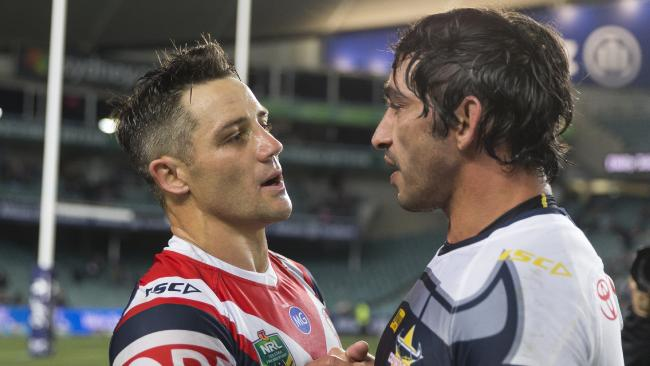 Cooper Cronk of the Roosters and Johnathan Thurston of the Cowboys hug after the match during the Round 21 NRL match between the Sydney Roosters and the North Queensland Cowboys at Allianz Stadium in Sydney, Saturday, August 4, 2018. (AAP Image/Craig Golding) NO ARCHIVING, EDITORIAL USE ONLY