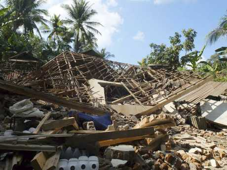 Houses damaged by an earthquake in North Lombok, Indonesia. Picture: AP Photo/Sidik Hutomo