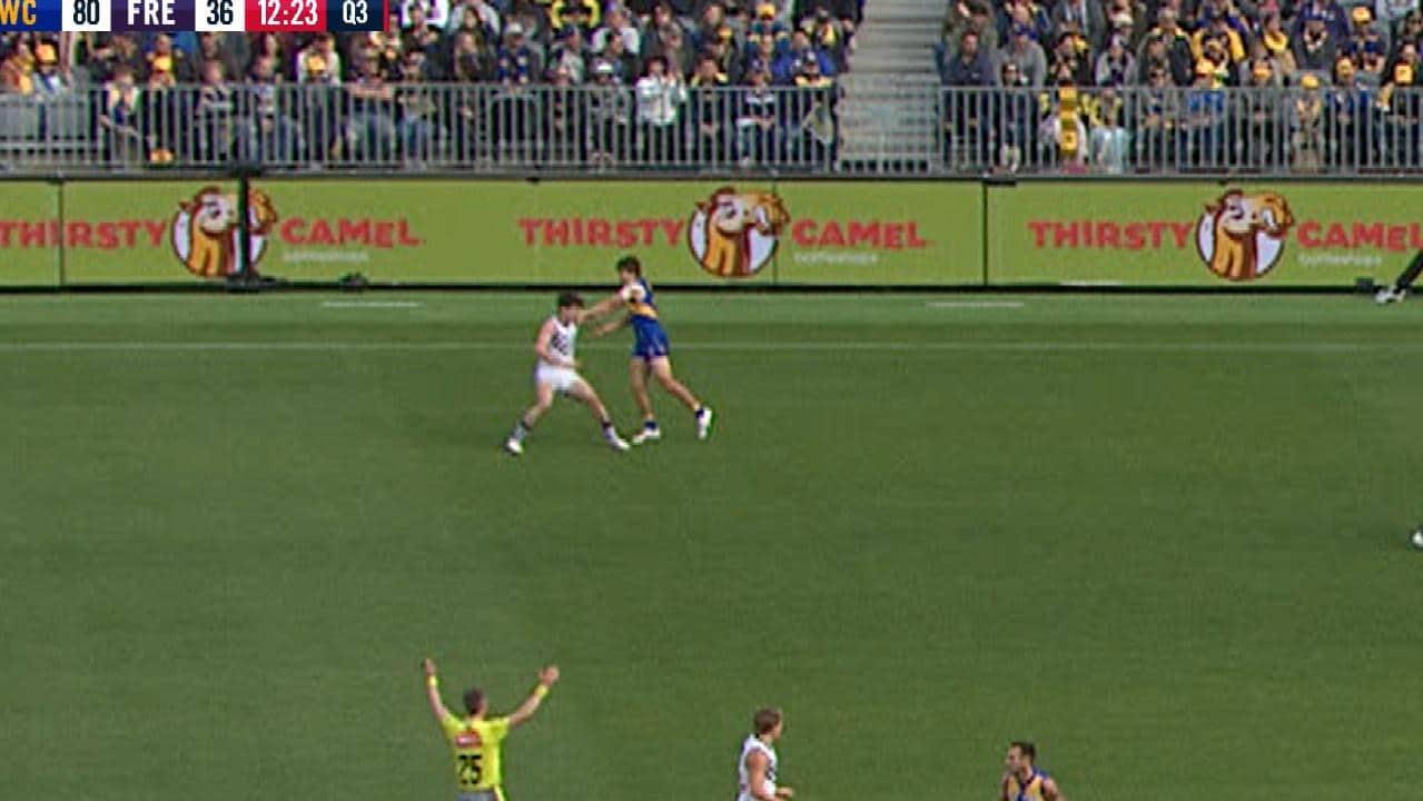 Andrew Gaff strikes Andrew Brayshaw.