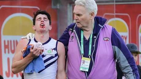 A Fremantle doctor helps Andrew Brayshaw after he was struck by Andrew Gaff.