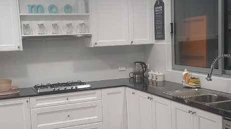This kitchen cost just $2500 and only needed a coat of paint. Picture: Facebook