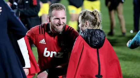 All Blacks captain Kieran Read with his daughter after winning the Super Rugby final.