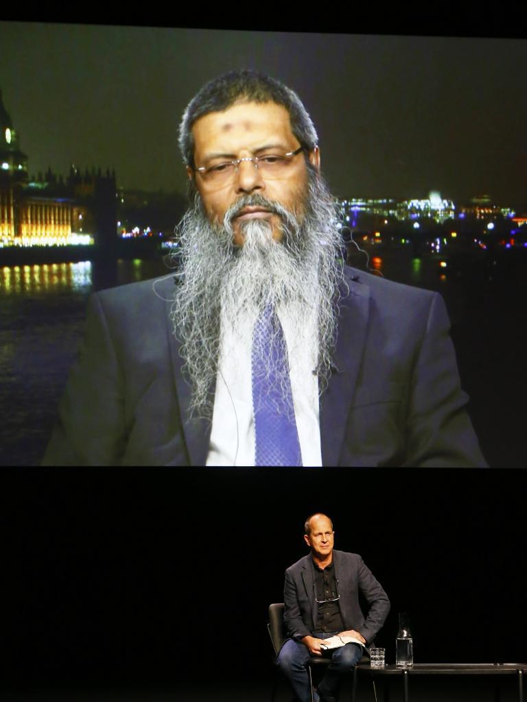 Journalist Peter Greste speaking to Manwar Ali via satellite link to a near full house at The Odeon Theatre, Hobart. Picture: MATT THOMPSON
