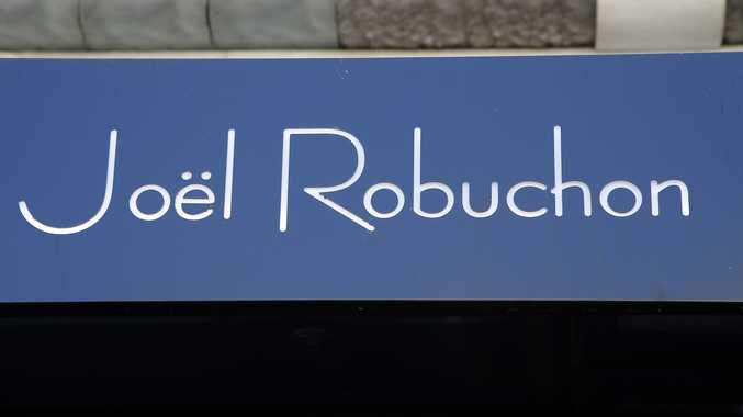 French chef Joel Robuchon's name is pictured on his restaurant in Paris, Monday, Aug.6, 2018. Robuchon, a master chef who shook up the stuffy world of French haute cuisine by wowing palates with the delights of the simple mashed potato and giving diners a peek at the kitchen, has died. He was 73. Photo: AP