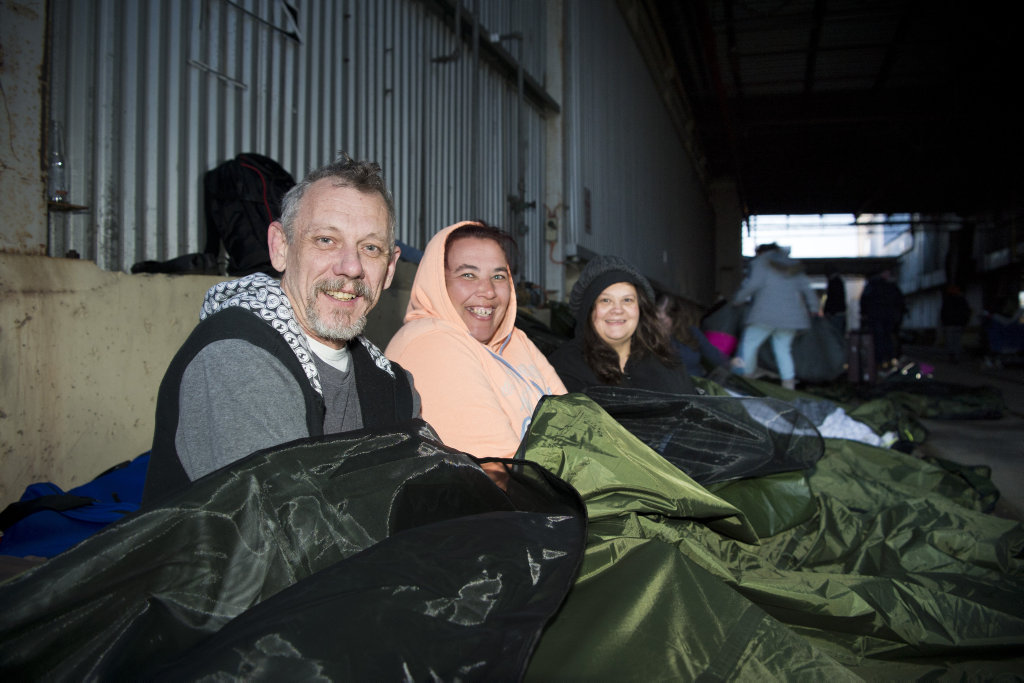 Waking up from sleeping rough are (from left) Mark Willmott, Tracey Hill and Michelle Hawkins for the Homeless For A Night event run by Base Services, Tuesday, August 7, 2018.