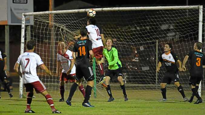 OVER: Bargara's Daniel Hardy heads the ball towards the goal against the United Park Eagles. The Reds won 4-2.