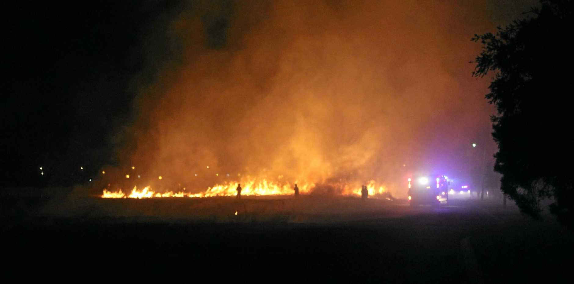 LIT UP: Kingaroy firefighters tackle the blaze on Kelvyn St on the second night, Saturday August 4 at 11pm.